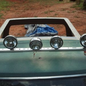 light bar and lights mounted and a whole in the roof